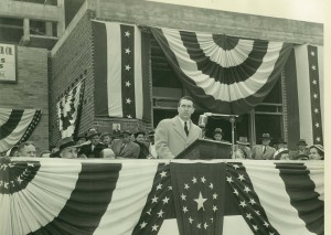 State Senate candidate James F. Murray, Jr. speaking at corner stone laying ceremony for James F. Murray School (PS 38) in 1953.